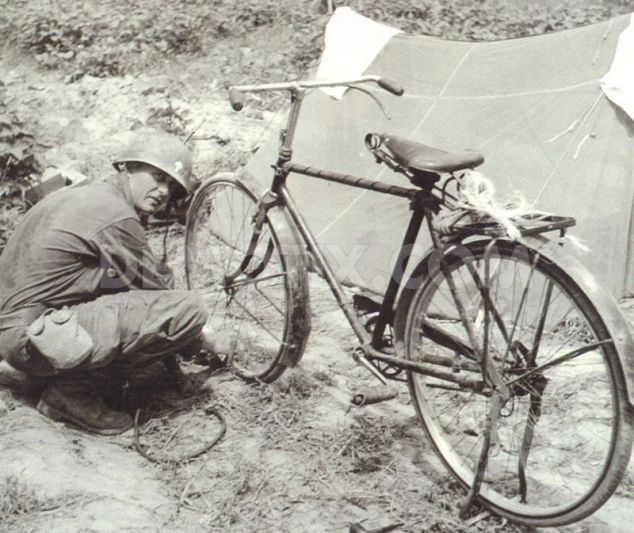 Father Kapaun With His Bicycle In Korea