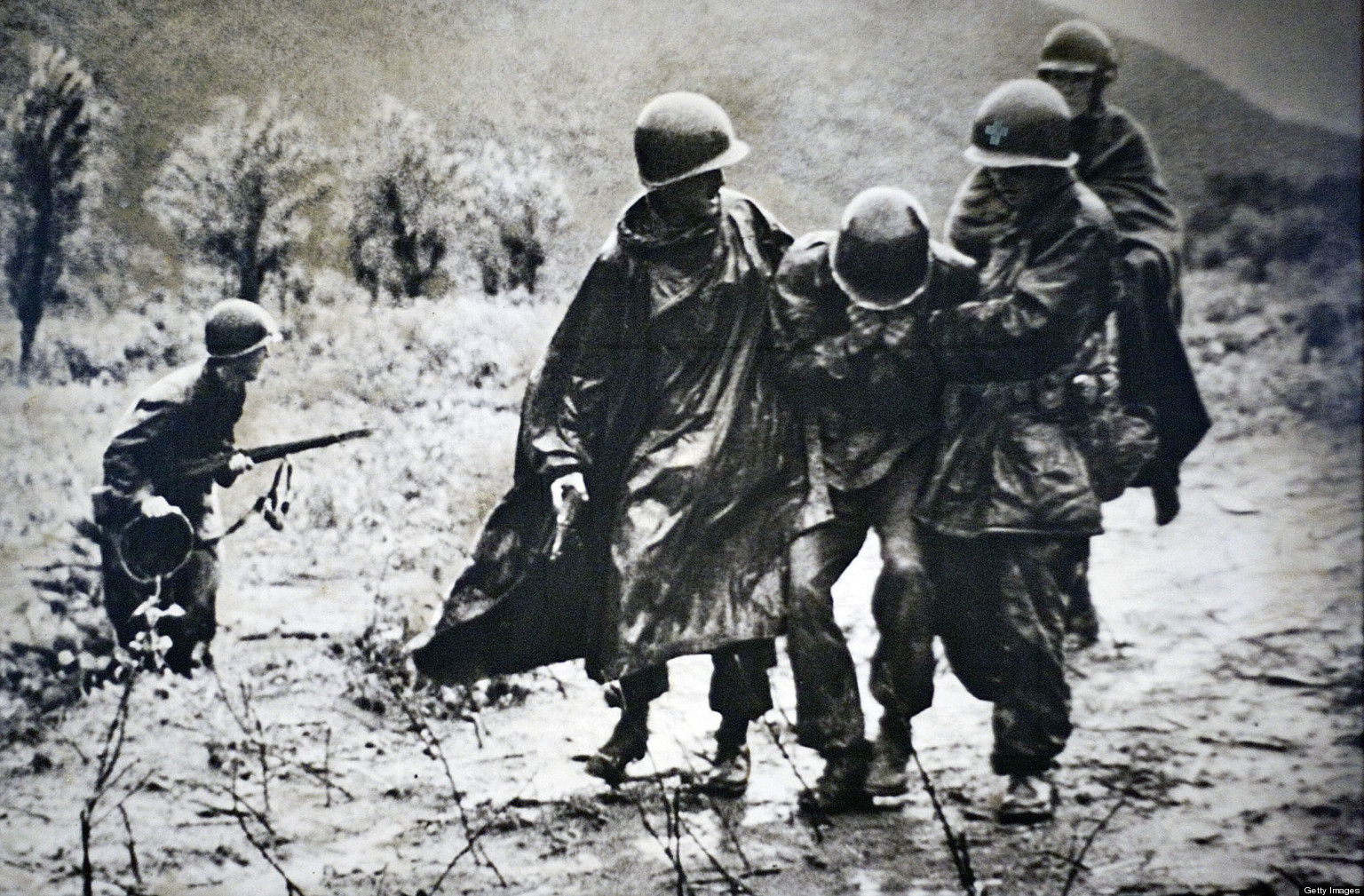 Father Kapaun Helping A Wounded Soldier