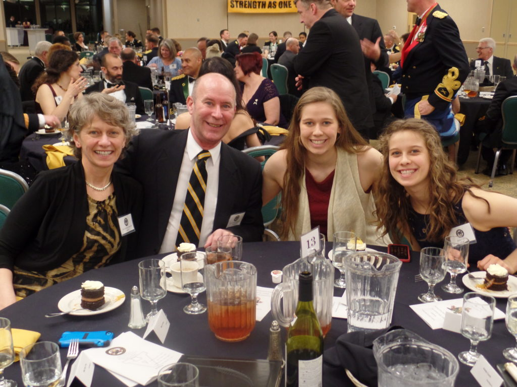 COL (Ret.) Robert Forbes '81, Mrs. Mary Forbes, Rachel Forbes and Emily Forbes