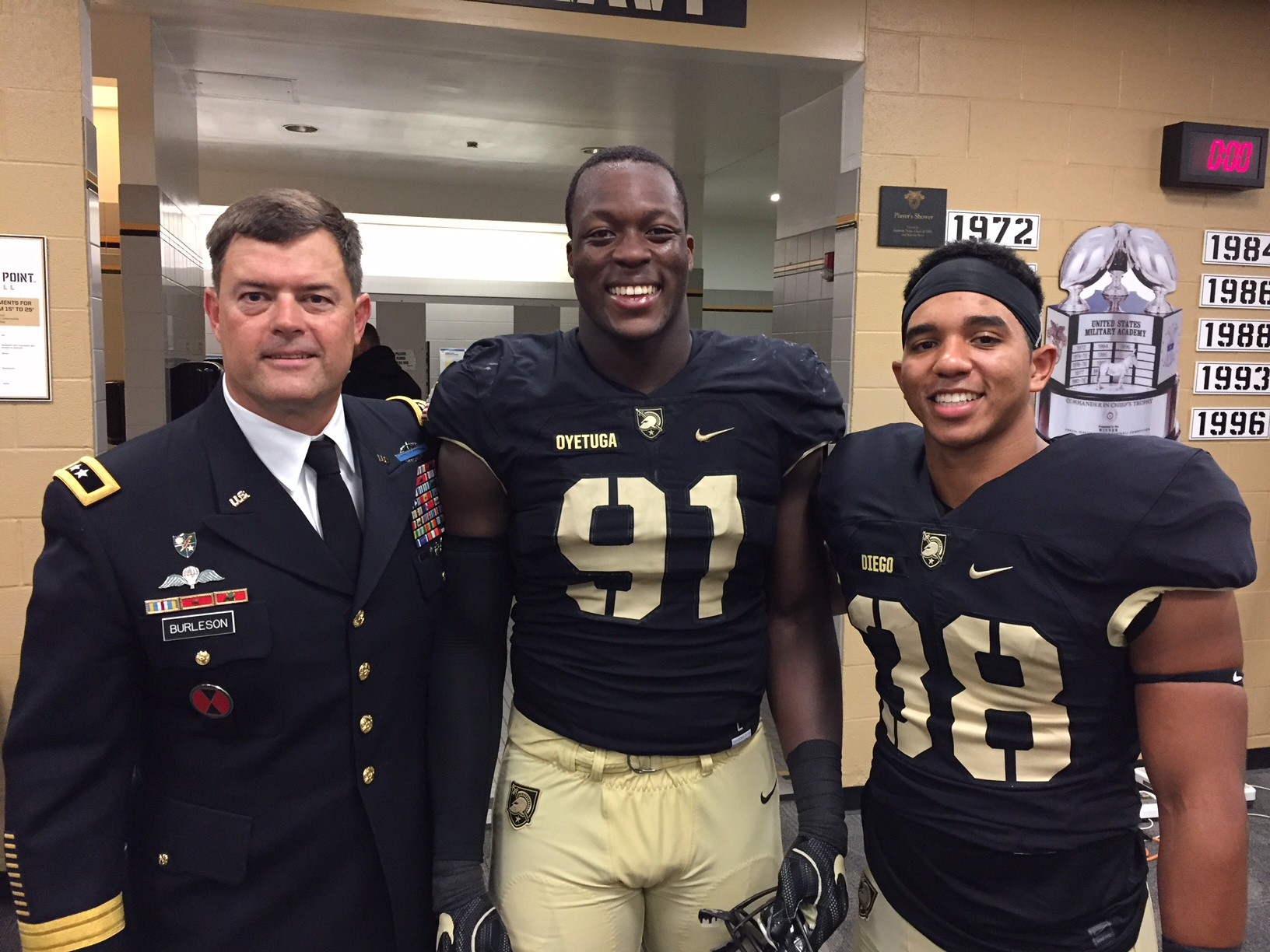 MG Bill Burleson, '88, Cadet Wunmi Oyetuga (#91) And Cadet Donnell Diego (#38)